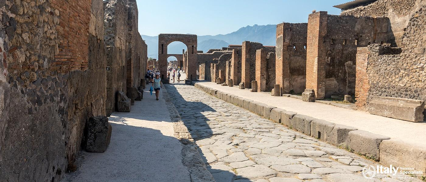 Pompeii, Italy - June 15, 2017 An ancient cobbled street in the ruins of Pompeii, Italy. Roman town