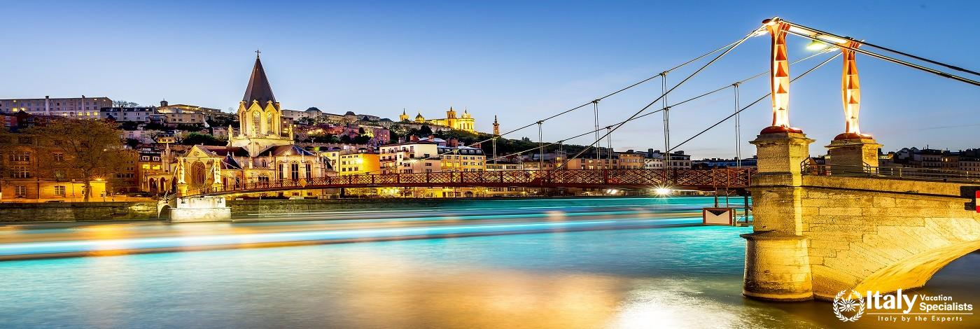 Night View from St Georges Footbridge in Lyon City with Fourviere Cathedral, France