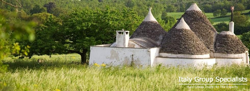 Trulli as seen in Puglia near Alberobello, Italy - www.italygroupspecialists.com