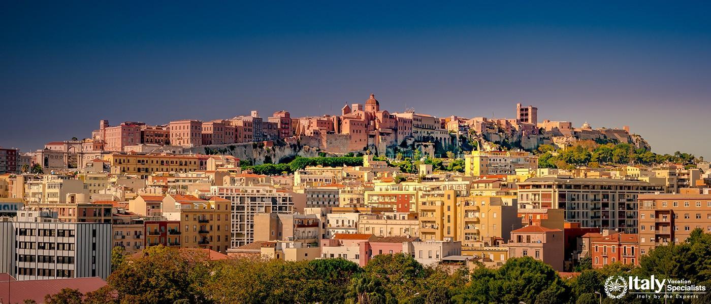Cagliari at sunset, capital of the region of Sardinia, Italy. Beautiful skyline image of the big cit