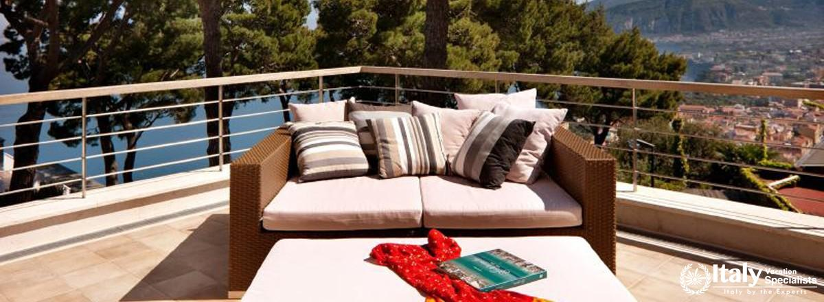 Sofa and table in terrace of Villa Moyria