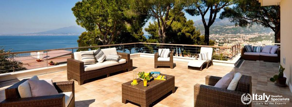 Outdoor sofas and sitting area in Villa Moyria