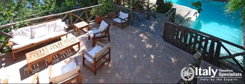 SItting area and swimming pool in Villa Aranceto