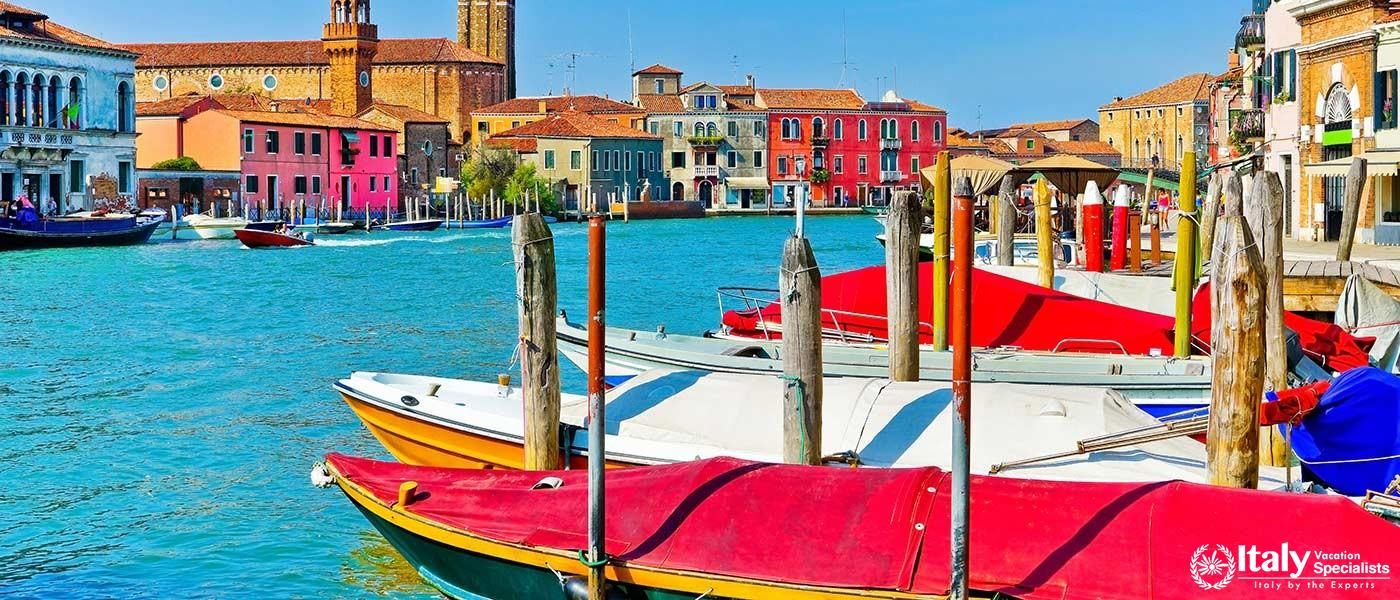 View of the colorful Venetian houses along the canal at the Islands of Murano in Venice