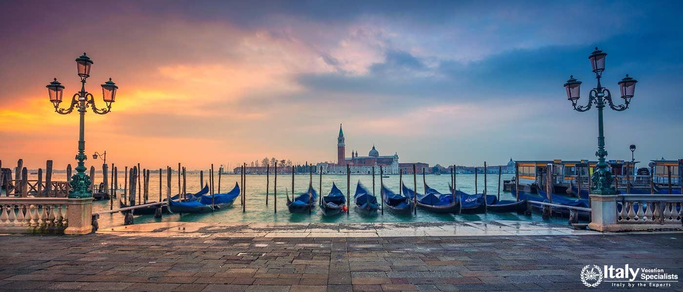 Panoramic cityscape image of Venice, Italy during sunrise