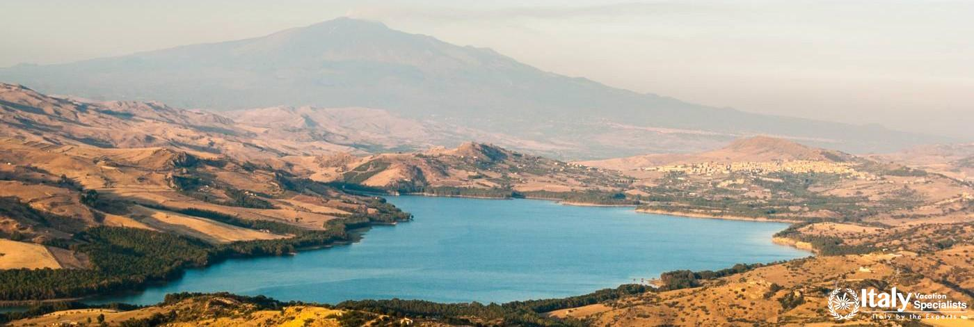 The lake of Pozzillo, with volcano Etna in background
