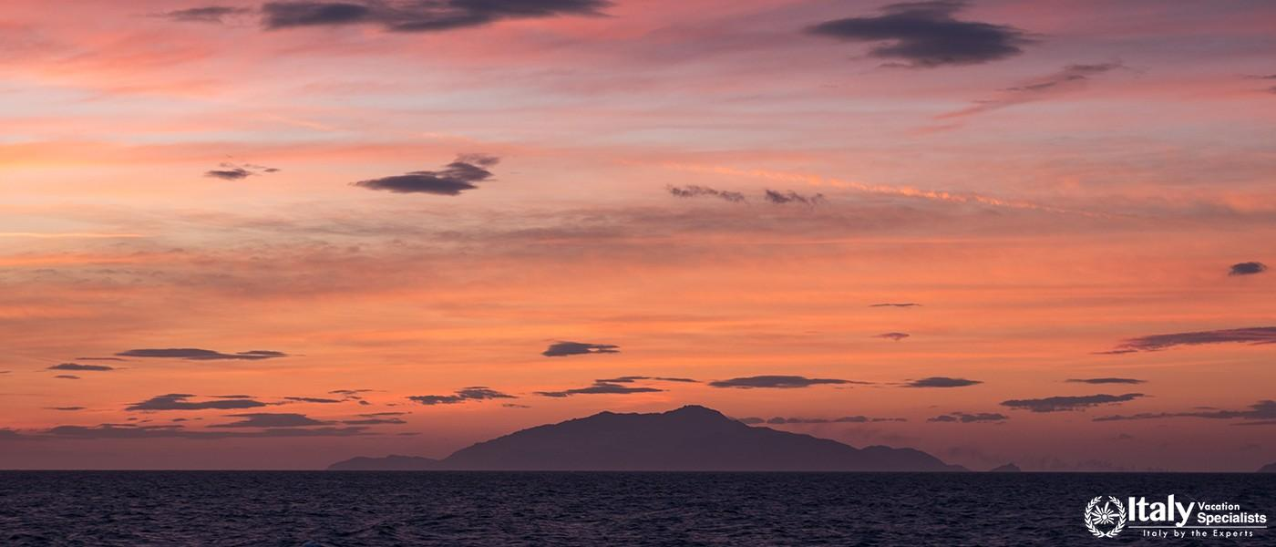 Sunset in the Bay of Naples, Italy. Mount Vesuvius can be seen on the horizon. Photographed near Sor