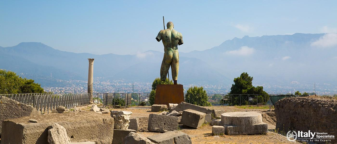 Man statue on square of ancient city of Pompei, Naples, Italy.