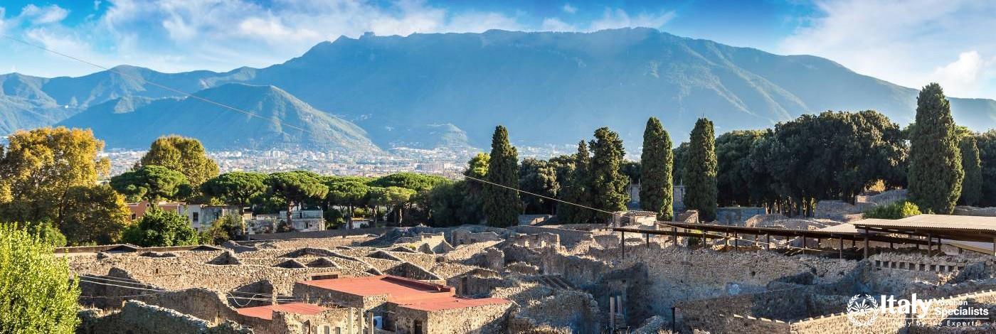 Mt. Vesuvius behind ruins of Pompeii, Italy